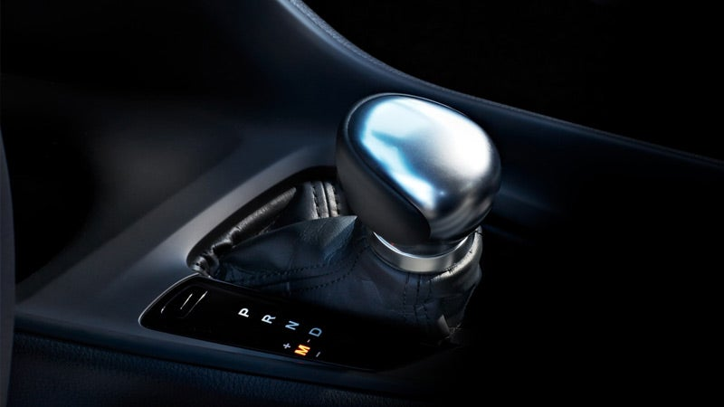 2019 Toyota CH-R Limited interior shown with standard leather-trimmed shift lever with satin-plated shift knob.
