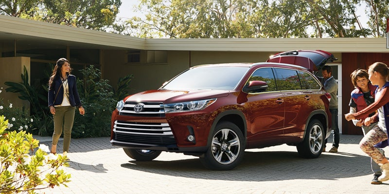 2019 Toyota Highlander Hybrid Limited shown in Ooh La La Rouge Mica with available Platinum Package