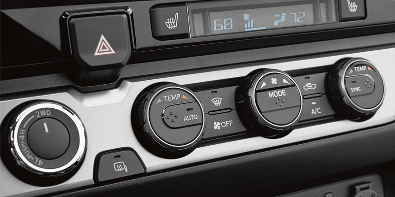 2019 Toyota Tacoma Limited Double Cab interior shown in Hickory leather trim with front dual zone automatic climate control. 2019 model shown with options.