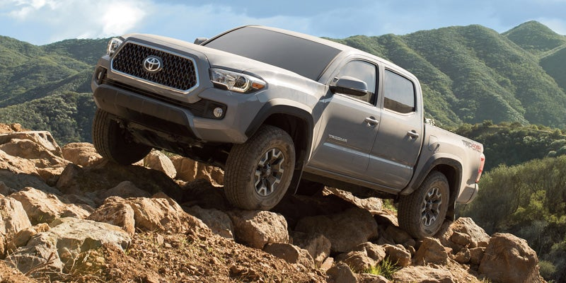 2019 Toyota Tacoma TRD Off-Road Double Cab shown in Cement with available Premium and Technology Packages and mudguards