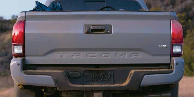 2019 Toyota Tacoma TRD Off-Road Double Cab shown in Cement with available Premium and Technology Packages and mudguards.